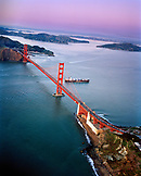 USA, California, San Francisco, an aerial view of a container ship passing under the Golden Gate Bridge, a view towards the Marin Headlands, Tiburon and Angel Island