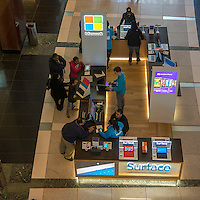Shoppers at the Microsoft kiosk, selling Windows 8 and the Surface tablet,  in the Time Warner Center in New York on Saturday, April 13, 2013. Microsoft has recently released an advertising campaign targeted against its competitor Google and their Android operating system.. (© Richard B. Levine)