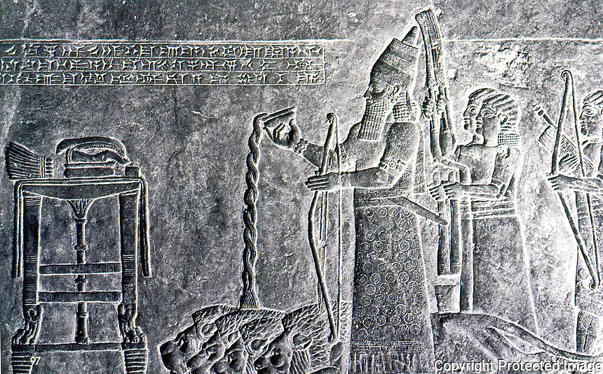 Assyria:  King Ashurbanipal making a libation over slain lions.  Photo '85.