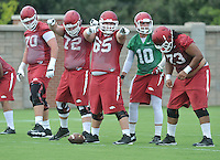 NWA Democrat-Gazette/MICHAEL WOODS &bull; @NWAMICHAELW<br /> University of Arkansas players Dan Skipper (70) Frank Ragnow (72) Mitch Smothers (65) Brandon Allen (10) and Sebastian Tretola (73) line up to run a play during the Arkansas Razorbacks practice Thursday August 6, 2015 in Fayetteville.