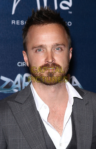 Aaron Paul.Red Carpet Premiere of Zarkana by Cirque Du Soleil at Aria Resort and Casino, Las Vegas, Nevada, USA, .9th November 2012..portrait headshot beard facial hair white shirt grey gray suit .CAP/ADM/MJT.© MJT/AdMedia/Capital Pictures.