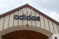 An Adidas store is pictured at the Settlers' Green Outlet Village in North Conway, New Hampshire Thursday June 13, 2013.