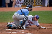 Kyle Parker #25 of the Clemson Tigers is tagged out at home by catcher Mark Fleury #8 of the North Carolina Tar Heels at Durham Bulls Athletic Park May 23, 2009 in Durham, North Carolina. The Tigers defeated the Tar Heals 4-3 in 11 innings.  (Photo by Brian Westerholt / Four Seam Images)