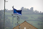 Matlock Town 0 Eastwood Town 3, 09/10/2010. Causeway Lane, FA Cup 3rd qualifying round. A club flag flutters outide the stadium advertising the FA Cup 3rd qualifying round tie between Matlock Town and Eastwood Town at Causeway Lane, Matlock with Riber Castle visible in the background. The visitors from Nottingham who play one division higher than Matlock won by three goals to nil to move to within one round of the FA Cup 1st round proper. The match was watched by 655 spectators. Photo by Colin McPherson.