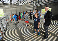 NWA Democrat-Gazette/ANDY SHUPE<br /> Dennis Chapman (right), president and head of school at The New School, leads a tour Wednesday, April 19, 2017, of the school's gymnasium during a beam raising and tour of the school's expansion project in Fayetteville. The New School hopes to open the facility in the fall for the 2017-18 school year.