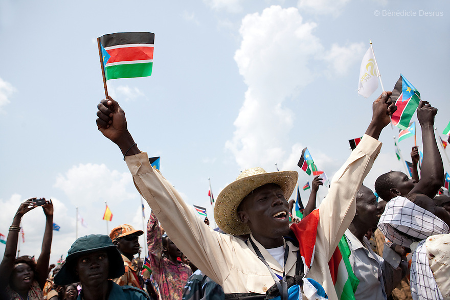 Saturday 9 july 2011 - Juba, Republic of South Sudan - A South Sudanese man waves the flag of his new country during celebrations marking South Sudan's independence in Juba as it seceded from the north and became the world's newest nation. Tens of thousands of citizens of the new South Sudan celebrate national independence but whether statehood will resolve issues of identity after a decades-long war remains to be seen. Photo credit: Benedicte Desrus