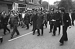 National Front march Manchester England. A left wing demonstrator harangues the NF who are protected by the police 1977