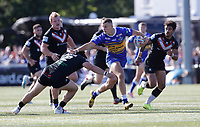 Ash Handley of Leeds holds off Rhys Williams during London Broncos vs Leeds Rhinos, Betfred Super League Rugby League at Trailfinders Sports Club on 1st September 2019