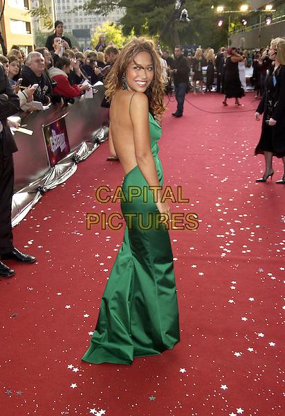 """MYLEENE KLASS.ITV's """"The Celebrity Awards"""".London 26 September 2004.full length, green, silk satin dress, windy, messy hair, backless.www.capitalpictures.com.sales@capitalpictures.com.©Capital Pictures"""