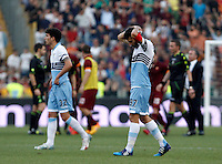 Calcio, Serie A: Lazio vs Roma. Roma, stadio Olimpico, 25 maggio 2015.<br /> Lazio's Danilo Cataldi, left, and Antonio Candreva leave the pitch at the end of the Italian Serie A football match between Lazio and Roma at Rome's Olympic stadium, 25 May 2015. Roma won 2-1.<br /> UPDATE IMAGES PRESS/Isabella Bonotto