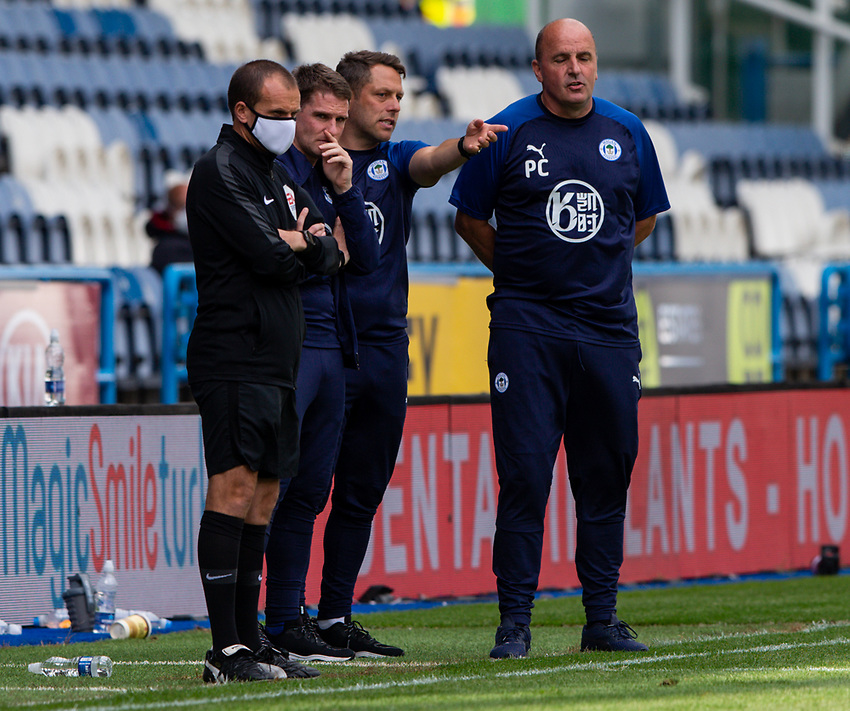 Wigan Athletic manager Paul Cook and his team watch on<br /> <br /> Photographer Alex Dodd/CameraSport<br /> <br /> The EFL Sky Bet Championship - Huddersfield Town v Wigan Athletic - Saturday 20th June 2020 - John Smith's Stadium - Huddersfield <br /> <br /> World Copyright © 2020 CameraSport. All rights reserved. 43 Linden Ave. Countesthorpe. Leicester. England. LE8 5PG - Tel: +44 (0) 116 277 4147 - admin@camerasport.com - www.camerasport.com