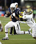 Nevada's Don Jackson (6) runs up the middle against UC Davis' Artice Nelson (11) during the first half of an NCAA college football game in Reno, Nev. on Thursday, Sept. 3, 2015. (AP/Cathleen Allison)