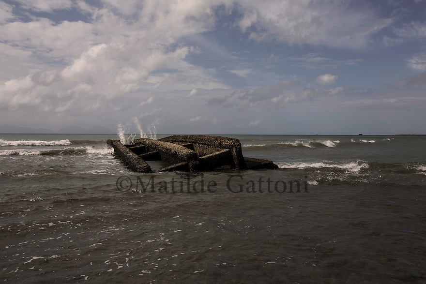 Indonesia - Sumatra - Banda Aceh - Lam Manyang - A bridge broken by the tsunami lies in the ocean. Several road infrastructures were destroyed by the powerful waves which greatly complicated the local and international first aid.