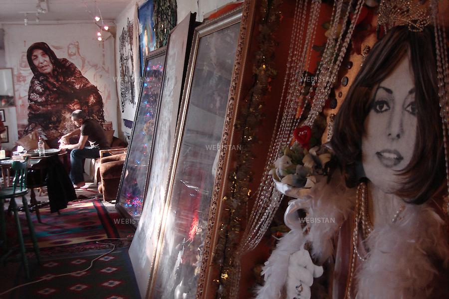 Iran. Tehran. Portrait of Iranian artist and painter, Khosrow Hasanzadeh at his studio among some of his works. Iran. Teheran. Portrait de l'artist plasticien et peintre iranien, Khosrow Hassanzadeh dans son atelier, au milieu de quelques uns de ses oeuvres.