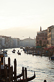 ITALY, Venice. View of the Grand Canal, Homes, Shops and Restaurants at sunset from the Rialto Bridge.