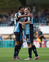 Garry Thompson of Wycombe Wanderers congratulates Aaron Amadi Holloway of Wycombe Wanderers on his goal during the Sky Bet League 2 match between Wycombe Wanderers and York City at Adams Park, High Wycombe, England on 8 August 2015. Photo by Andy Rowland.