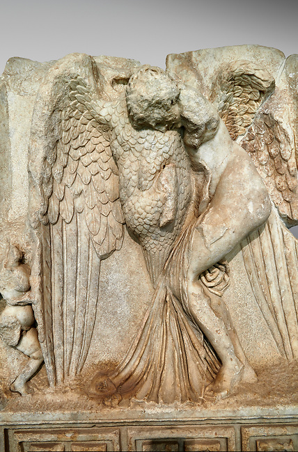 Close up of a Roman Sebasteion relief  sculpture of Leda and swan, Aphrodisias Museum, Aphrodisias, Turkey. <br /> <br /> Zeus disguised as a swan assaults Spartan princess Leda. The bird stands on the tips of its outspread wings and presses its webbed foot on the thigh of modest, struggling Leda. The swan is supported from behind a small Eros. From this encounter came a large egg from which were born Helen and the Dionskouroi twins, Kastor and Polydeukes