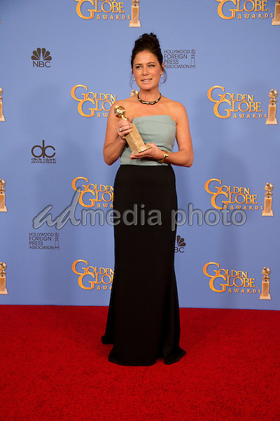"""After winning the category of BEST PERFORMANCE BY AN ACTRESS IN A SUPPORTING ROLE IN A SERIES, MINI-SERIES OR MOTION PICTURE MADE FOR TELEVISION for her role in """"The Affair,"""" actress Maura Tierney poses backstage in the press room with her Golden Globe Award at the 73rd Annual Golden Globe Awards at the Beverly Hilton in Beverly Hills, CA on Sunday, January 10, 2016. Photo Credit: HFPA/AdMedia"""
