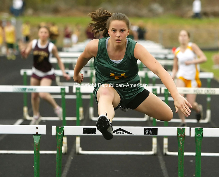 WATERBURY, CT 5/01/07- 050107BZ04- Holy Cross's Katie Ciarleglio leads the pack in the 100M hurdles Tuesday afternoon.<br /> Jamison C. Bazinet Republican-American
