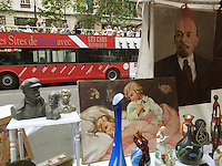 France. Department Ile-de-France. Paris. Flea market on sunday morning on Boulevard des Capucines. Objects for sale. An old painting with Lenin and a double decker bus used by tourists. Vladimir Ilyich Lenin (1870- 1924) was a Russian Marxist revolutionary and communist politician who led the October Revolution of 1917. As leader of the Bolsheviks, he headed the Soviet state during its initial years (1917-1924), as it fought to establish control of Russia in the Russian Civil War and worked to create a socialist economic system. As a politician, Lenin was a persuasive orator, as a political scientist his extensive theoretic and philosophical developments of Marxism produced Marxism Leninism, the pragmatic Russian application of Marxism. 10.07.2011 © 2011 Didier Ruef