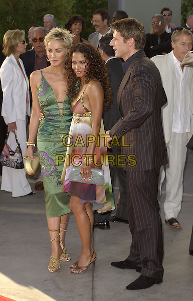Sharon Stone, Halle Berry & Lambert Wilson .Warner Brothers' World Premiere of Catwoman held at The Arclight Cinerama Dome Theatre in Hollywood, California on July 19,2004..full length green and purple low cut dress plunging neckline floaty multi-coloured striped dress gold jewellery bangles.Ref: DVS.www.capitalpictures.com.sales@capitalpictures.com.©Capital Pictures.