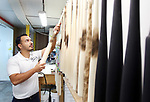 WATERBURY CT. 11 March 2018-031119SV22-Freddie Vargas holds works with the professional baseball bats his company, Tater , makes in Waterbury Monday.<br /> Steven Valenti Republican-American