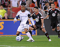 New England Revolution defender Cory Gibbs (12) shields the ball against DC United forward Jaime Moreno (99).  New England Revolution defeated DC United 2-0,  at  RFK Stadium, Saturday April 3, 2010.