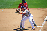 Reading Fightin Phils first baseman Rhys Hoskins (12) waits for a throw as base runner Ryan Lavarnway gets back to the bag during a game against the New Hampshire Fisher Cats on June 6, 2016 at FirstEnergy Stadium in Reading, Pennsylvania.  Reading defeated New Hampshire 2-1.  (Mike Janes/Four Seam Images)