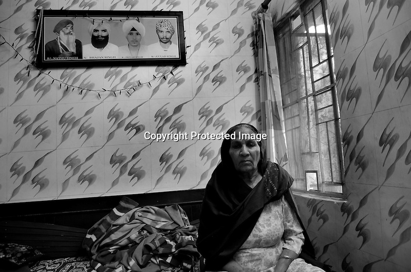 Jasbeer Kaur is a widow and a rape victim from the Sikh Genocide of 1984 presently residing at the widow colony in Tilak Vihar. Tilak Vihar in New Delhi is called the widow colony. Widows and children of the Sikhs who were killed in 1984 Sikh Genocide live here. Four thousand Sikhs were killed in 72 hours in Delhi alone but no body till date has been punished for such an inhuman crime. Illiteracy, drug addiction, child labour and immense poverty characterize the area. Twenty five years ago all the male family members above the age of 15 were killed and burnt, leaving their uneducated widows and children behind to suffer, even after 25 years. The present generation is jobless, steeped in alcoholism and have lost their directions in life. November 2009. New Delhi, India, Arindam Mukherjee