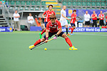 The Hague, Netherlands, June 10: Jonghyun Jang #25 of Korea passes the ball during the field hockey group match (Men - Group B) between Germany and Korea on June 10, 2014 during the World Cup 2014 at Kyocera Stadium in The Hague, Netherlands. Final score 6-1 (3-0) (Photo by Dirk Markgraf / www.265-images.com) *** Local caption ***