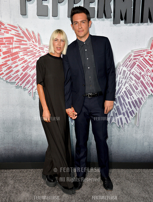 """LOS ANGELES, CA. August 28, 2018: John Boyd & Nicole Vicius at the world premiere of """"Peppermint"""" at the Regal LA Live."""