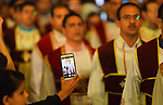 Egyptian Coptic Christians take part in an Easter Eve mass hosted by Pope Tawadros II at the St. Mark church in Cairo April 15, 2017. Photo by Amr Sayed