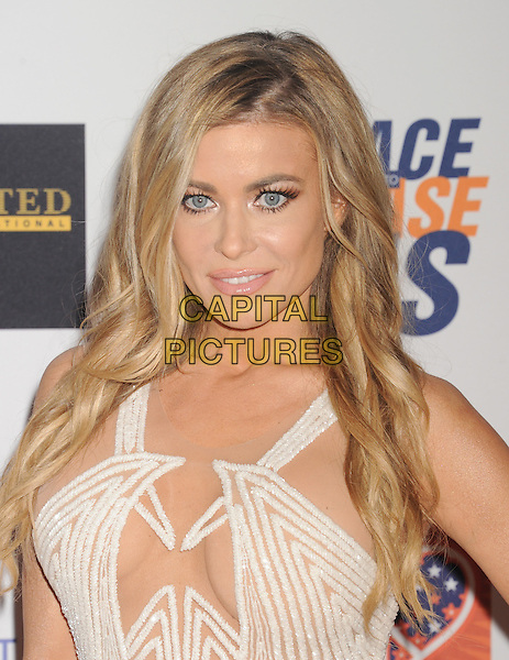 CENTURY CITY, CA - APRIL 24: Actress Carmen Electra arrives at the 22nd Annual Race To Erase MS at the Hyatt Regency Century Plaza on April 24, 2015 in Century City, California.