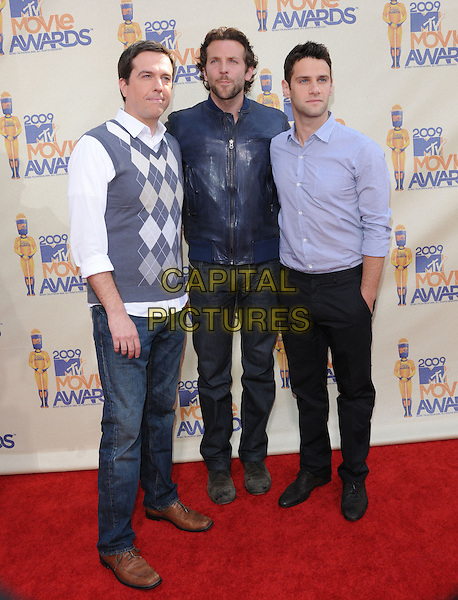 ED HELMS, BRADLEY COOPER & JUSTIN BARTHA .The 2009 MTV Movie Awards held at Universal Ampitheatre  in Universal City, California, USA..May 31st, 2009  .full length blue leather jacket shirt grey gray white argyle pattern vest top stubble facial hair .CAP/DVS.©Debbie VanStory/Capital Pictures.