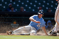 North Carolina Tar Heels first baseman Cody Stubbs #25 slides into home against the California Golden Bears in the NCAA baseball game on March 2nd, 2013 at Minute Maid Park in Houston, Texas. North Carolina defeated Cal 11-5. (Andrew Woolley/Four Seam Images).