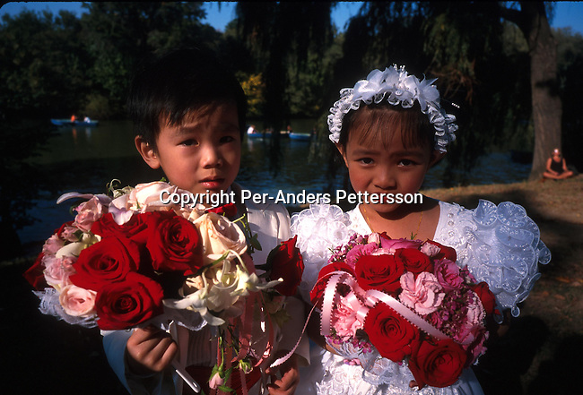 A young Chinee boy and a girl attending a wedding on June 28, 1997 in Central Park,  New York City, New York, USA. The park is the life line for New Yorker and tourists..Photo: Per-Anders Pettersson/ iAfrika Photos
