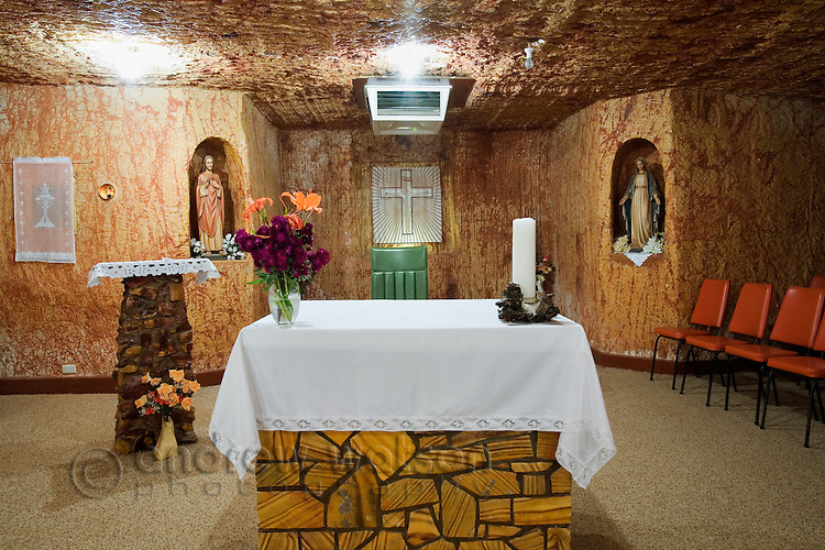 The altar of the St Peter and Paul Catholic Church.  The church is one of five underground churches in the outback town of Coober Pedy, South Australia, AUSTRALIA.