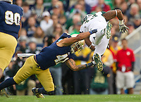 Safety Matthias Farley (41) tackles Michigan State Spartans running back Jeremy Langford (33) in the third quarter.