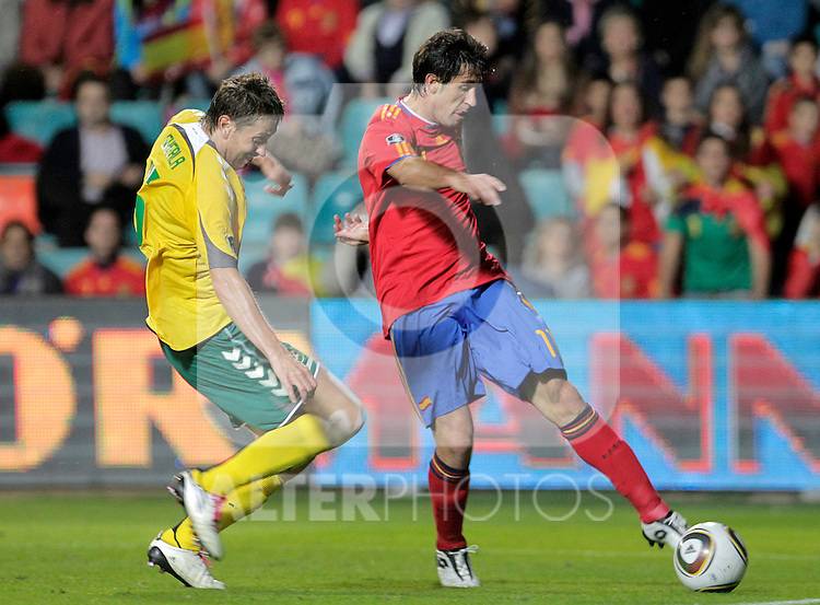 Spain's Joan Capdevila (r) and Lithuania's Andrius Skerla during UEFA Eurocup 2012 qualifying match.October 8,2010. (ALTERPHOTOS/Acero)