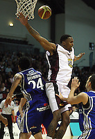 Saints import Mike Efevberha fouls Heat import Mike Bell (right) during the National Basketball League match Wellington Saints and Harbour Heat at TSB Bank Arena, Wellington, New Zealand on Saturday 13 June 2009. Photo: Dave Lintott / lintottphoto.co.nz