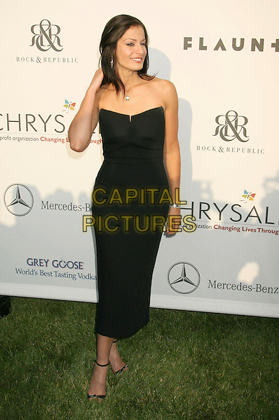 DAYANARA TORRES.Sixth Annual Chrysalis Butterfly Ball held at the Home of Susan Harris and Hayward Kaiser, Mandeville Canyon, California, USA..June 2nd, 2007.full length black strapless dress .CAP/ADM/RE.©Russ Elliot/AdMedia/Capital Pictures *** Local Caption *** ..