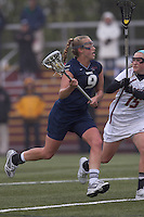 University of New Hampshire midfielder Ilana Cohen (9) on the attack as Boston College defender Jessie Coffield (15) defends. Boston College defeated University of New Hampshire, 11-6, at Newton Campus Field, May 1, 2012.