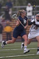 University of New Hampshire midfielder Ilana Cohen (9) on the attack as Boston College defender Jessie Coffield (15) defends. Boston College defeated University of New Hampshire, 11-6, at Newton Campus Field, May 1, 2012.