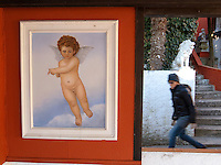 "Switzerland. Canton Ticino. Lugano. A framed painting of  an angel on the terrace of the hotel Elvezia al Lago, on the walking path ""Sentiero Olivo to Gandria"". The hotel is closed for the winter season. 22.01.11 © 2011 Didier Ruef"