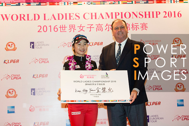 Hye Youn Kim of South Korea receives a hole-in-one trophy from the hands of Iain Roberts during the Prize giving ceremony of the World Ladies Championship 2016 on 13 March 2016 at Mission Hills Olazabal Golf Course in Dongguan, China. Photo by Victor Fraile / Power Sport Images