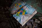 Pisky, Nr Avdiivka, eastern Ukraine, Nov. 2017.<br /> <br /> Textbook showing a map of Ukraine with Russia torn out, in what remains of the school in the devastated village of Pisky, on the outskirts of Avdiivka in eastern Ukraine.<br /> <br /> The village is on the front-line and under frequent attack by sniper, rocket and artillery fire from pro-Russian separatists.