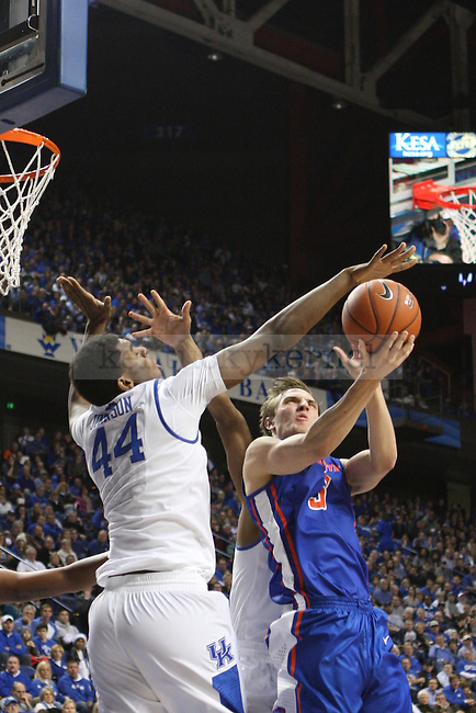 UK center Dakari Johnson blocks Boise State guard Anthony Drmic during the first half of the University of Kentucky men's basketball game vs. Boise State at Rupp Arena in Lexington, Ky., on Tuesday, December, 10, 2013. Photo by Jonathan Krueger | Staff