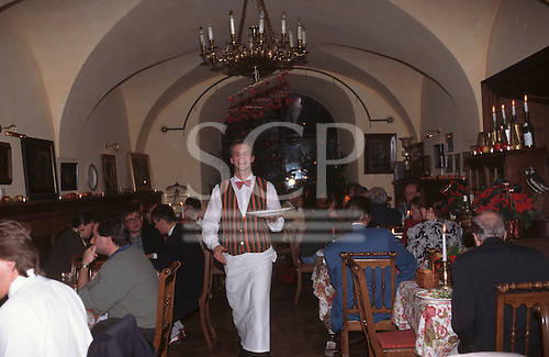 Warsaw, Poland. Smiling waiter in red bow tie at the Fukier Restaurant.