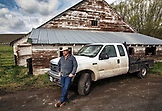 USA, Oregon, Enterprise, Portrait of Cowboy and Rancher Todd Nash in front of his truck at the Snyder Ranch in North East Oregon between Enterprise and Joseph