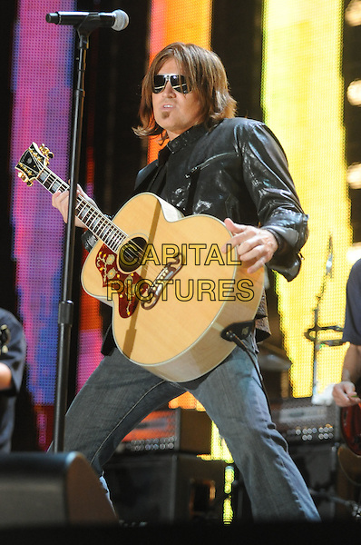 BILLY RAY CYRUS.2008 CMA Music Festival Nightly Concert held at LP Field, Nashville, Tennessee, USA..June 8th, 2008.stage concert live gig performance music half length guitar black leather jacket full 3/4 jeans denim sunglasses shades .CAP/ADM/MS.©Mike Strasinger/AdMedia/Capital Pictures.
